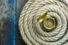 Nautical background. Old deck with rope and compass. Nautical navigation background. Old deck with rope and compass royalty free stock photos