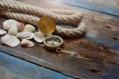 Free Nautical Background. Old Deck With Rope, Compass And Shells Royalty Free Stock Photos - 134805068