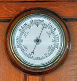 Nautical Barometer. The Nautical Barometer on an Old Sailing Vessel stock photo