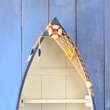 Nautical boat shape shelves on wooden table. product display background, vintage filtered.  Stock Photos