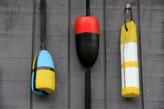 Nautical buoys on gray wall Stock Photography