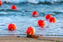 Nautical buoys in sea water close up stock photography