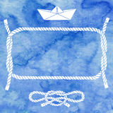 Nautical card with frame, marine knots and paper boat on blue wa Royalty Free Stock Photos