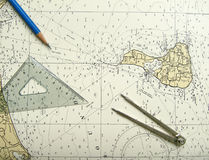 Nautical chart and divider Stock Photos