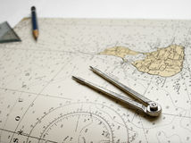 Nautical chart dividers pencil Stock Image