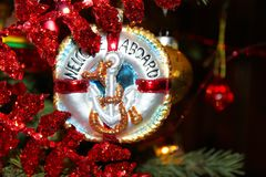 Nautical Christmas Ornament with anchor that says Welcome Aboard on Chistmas tree Stock Photography