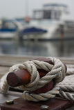 Nautical Cleat closeup with boat in background stock image