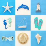 nautical collage with sea life style objects over blue and white wooden background. Stock Photo