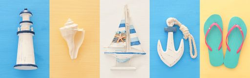 nautical collage with sea life style objects over blue and white wooden background. stock image