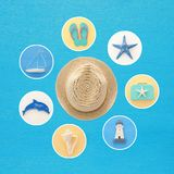 nautical collage with sea life style objects over blue wooden background. Stock Photos