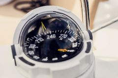 Nautical compass. Close up of nautical compass on yacht Royalty Free Stock Photo