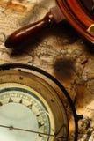 Nautical compass and wheel stock image