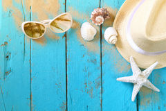 Nautical concept with fedora hat, sunglasses and seashells Stock Photos