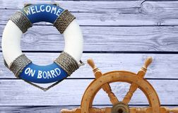 Nautical concept with lifebuoy and ship steering wheel stock images