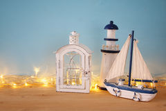Nautical concept with sea life style objects and gold garland lights Stock Photography