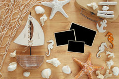 Nautical concept with sea life style objects on wooden table. For photography montage.  stock image