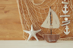 Nautical concept with sea life style objects on wooden table. Royalty Free Stock Images