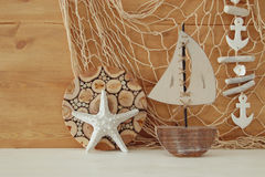 Nautical concept with sea life style objects on wooden table. Royalty Free Stock Photography