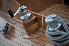Winch with rope on a wooden boat royalty free stock images