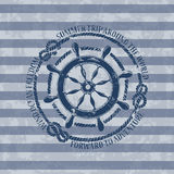 Nautical emblem with sea wheel Stock Images