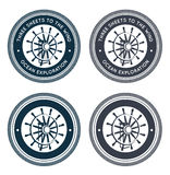 Nautical emblem with steering wheel Stock Photos