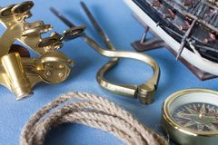Nautical equipment. Various pieces of nautical equipment on blue background Stock Images
