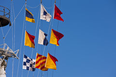 Nautical Flags. Three rows of nautical flags against a blue sky Royalty Free Stock Images