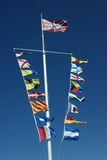 Nautical flags. On a background of the sky royalty free stock photo