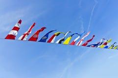 Nautical flags. The Nautical flags against blue sky Stock Photo