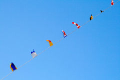Nautical flags against blue sky Stock Photo