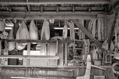 Nautical gear in a boat builders shop. Nautical working gear with sails and roping hanging in a boat builder and boat restoration workshop on the Chesapeake bay royalty free stock photo