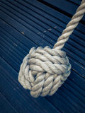 Nautical knot on blue background Stock Image
