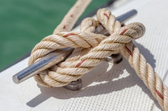 Nautical knot rope tied around stake on boat or ship Royalty Free Stock Photography
