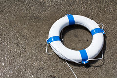 Nautical life saver floating on the water Stock Photography