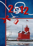 Nautical Light. Red lighthouse with 2012 holiday greetings Stock Images