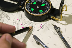 Nautical Map. Navigational tools and compass on a nautical navigation map Royalty Free Stock Photography