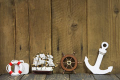 Nautical or maritime decoration on a old wooden background. Royalty Free Stock Image