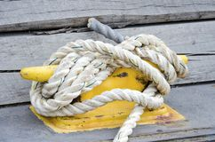 Nautical Mooring. Ship ropes with tied to a cleat with nautical knots Royalty Free Stock Photo