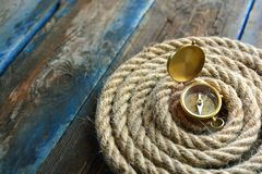 Nautical background. Old deck with rope and compass. Nautical navigation background. Old deck with rope and compass royalty free stock images