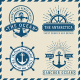 Nautical, Navigational, Seafaring and Marine insignia logotype vintage design. With anchor, rope, steering wheel, star burst, sunburst | Only Free Font Used Royalty Free Stock Photo