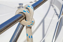 Nautical part of a yacht with cords, rigging, sail, mast, anchor, knots . Stock Photos