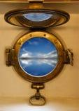 Nautical porthole. View on blue sea through nautical porthole Royalty Free Stock Image
