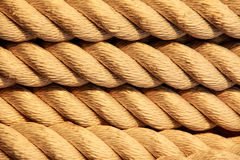 Nautical rope background. Nautical rope in spiral on board warship Royalty Free Stock Image