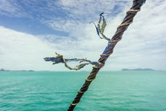 Nautical Rope blowing in the breeze. Nautical rope blowing in the tropical wind over turquoise waters royalty free stock images