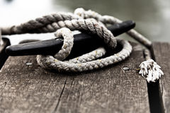 Nautical rope on the cleat. Close-up of nautical rope tied on a cleat Stock Photo