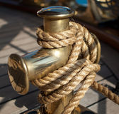 Nautical rope on the cleat. Close-up of nautical rope tied on a cleat Stock Image
