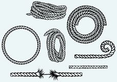 Nautical rope knots. Isolated on blue background Stock Images