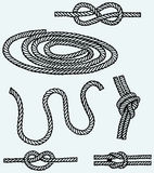 Nautical rope knots. Isolated on blue background Royalty Free Stock Images