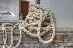 Nautical Rope. Old Weathered Nautical Rope In a Pile on a Ledge Stock Photography