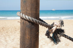 Nautical rope tied to a pole Stock Photos
